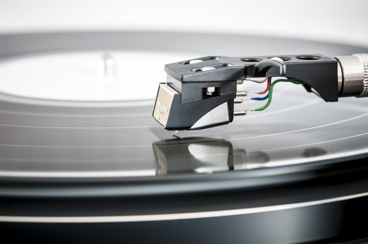 Record on a turntable –a phono cartridge alignment protractor is used for setting up a turntable